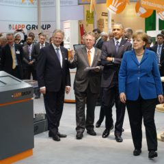 President Barack Obama and German Chancellor Angela Merkel Visit Lapp's Booth at Hannover Trade Fair